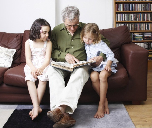 Good Hearing is important for family life - Picture of man reading to grand children - Access Hearing Centre, Dun Laoghaire, Co. Dublin, Ireland